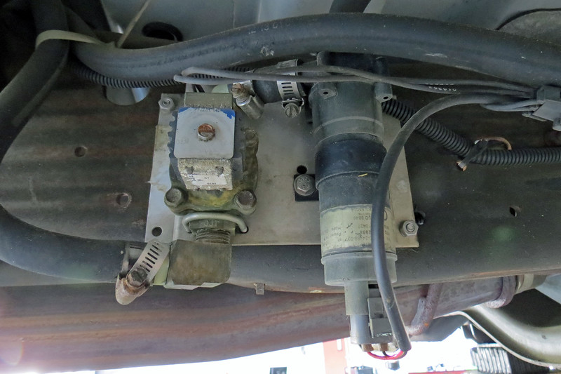 There is an auxiliary coolant pump and a valve mounted on the right side of the frame.
