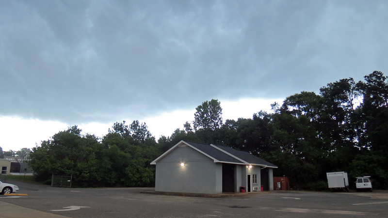 The darkness was accompanied by a few rumbles of thunder.  Light rain began to fall.
