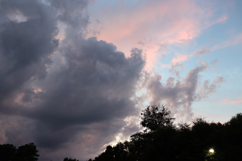 The photo above shows the dark layer of clouds below a more colorful layer.