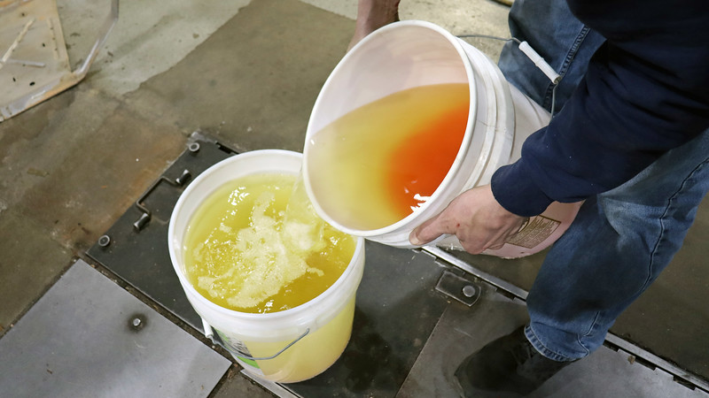 Shop Foreman Phil poured the gasoline off the top of bucket number 1 into bucket number 2.