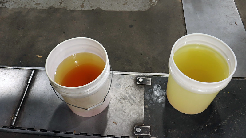 I removed the fuel tank and started draining.  The first bucket, (on the left in the photo above), came out very red at first before gradually changing over to yellow.  The second bucket came out mostly yellow.