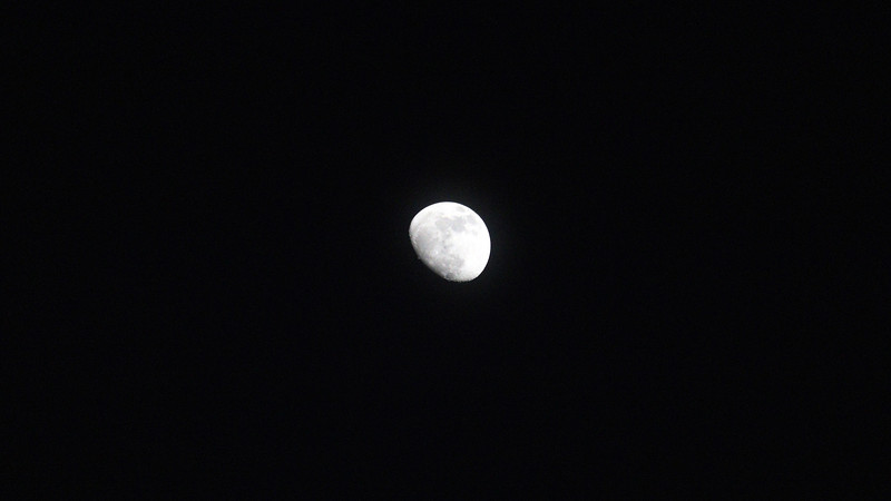 With the skies mostly clear, I broke out the 250 mm lens to take a few pics of the moon.