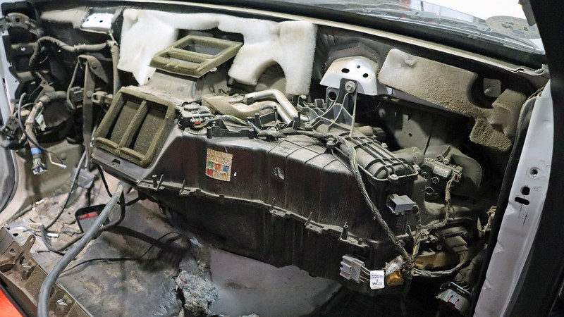 The HVAC case contains both the heater core and evaporator core plus all the necessary movable doors that direct hot or cold air to the various vents.  Access to the evaporator core requires removing the HVAC case from the bulkhead.