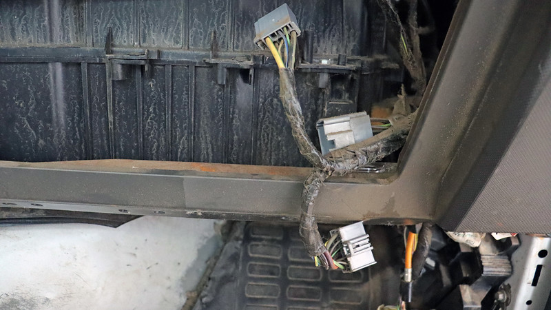 On the passenger's side of the truck, I removed the glove box to access the electrical connectors for the HVAC case.