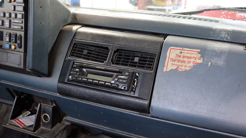 It looks like someone installed, (or tried to install), an aftermarket radio.