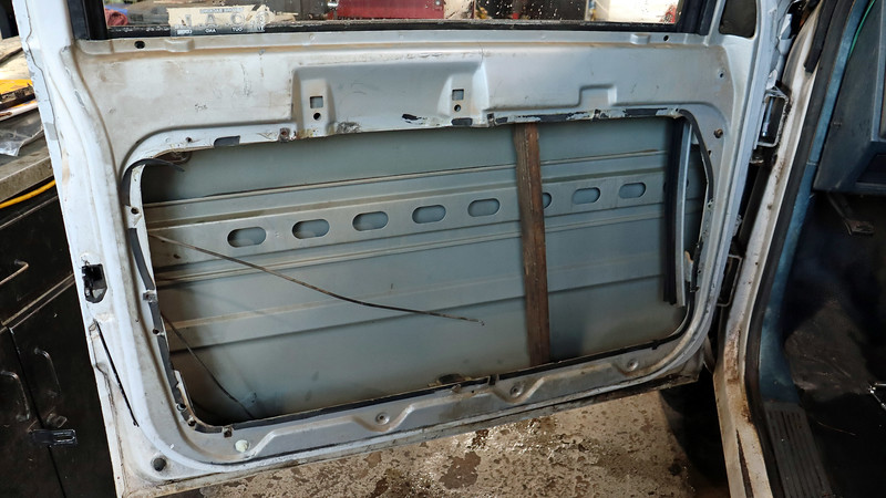 Accessing the door latch and linkage rods requires the removal of the door trim panel and the door access panel.  GM pickups from this era actually have a pretty decent design where the window regulator is attached to a large access panel that can be removed from the door which provides a lot of working room.