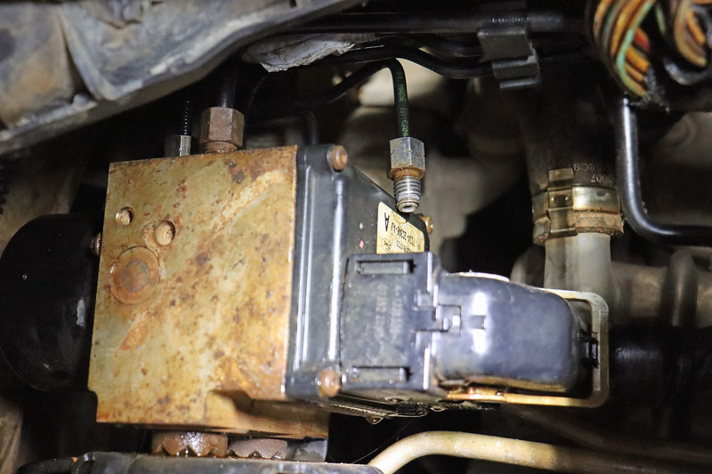 Working backwards, I then loosened the line at the ABS pump and had Jamie push the brake pedal again.  The resulting waterfall of brake fluid told me that everything was fine from the brake fluid reservoir all the way through the ABS pump.