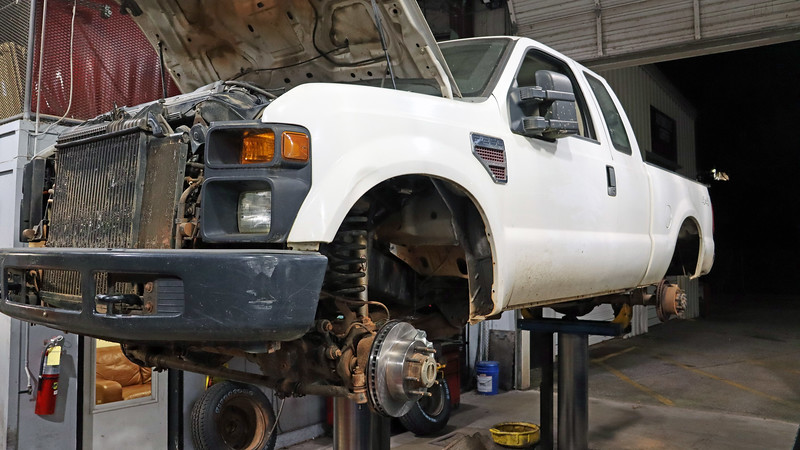 """One of my duties at the Auto Center is to perform """"Return to Service,"""" (RTS) inspections.  Vehicles are transferred internally from department to department with regularity at UGA.  When a department is fortunate enough to secure funding for a new vehicle, the one being replaced is evaluated to see if it can be """"returned to service"""" to a department who is in need of a vehicle but has no funding.  My role is this process is to ensure that the vehicle in question is roadworthy which is done via a thorough road test and an in-depth evaluation.  <br /> <br /> The easiest way to describe an RTS inspection is that it's a combination of a state-mandated safety inspection, (like I did in Pennsylvania and Missouri), and a multipoint inspection, (like I did as a Ford service technician when performing a regular maintenance service).  In other words, the vehicle is given a good once-over, and an estimate is prepared for any problems found.  <br /> <br /> The 2008 Ford F250 pickup seen in the photo above arrived for an RTS inspection in October which revealed a myriad of brake issues that featured leaks, wrong parts, pads worn metal-to-metal, a broken caliper piston, and a hard left turn with application of the brake pedal. Once everything on the estimate was approved, I started making all the repairs."""