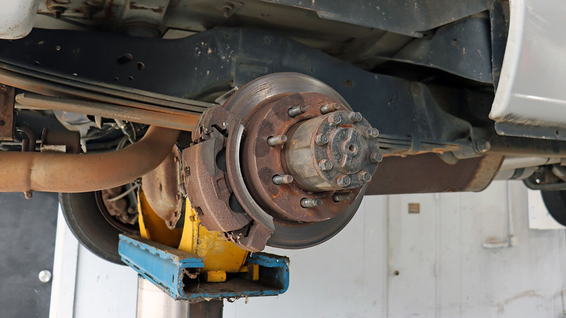 The brake pads and rotors seemed normal.  But what's wrong with the caliper bracket ?