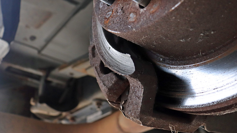 Whatever got caught in between the wheel and caliper bracket caused a good bit of damage to the caliper bracket.  Justin was, understandably, confused by this.  Then he looked at the wheel.