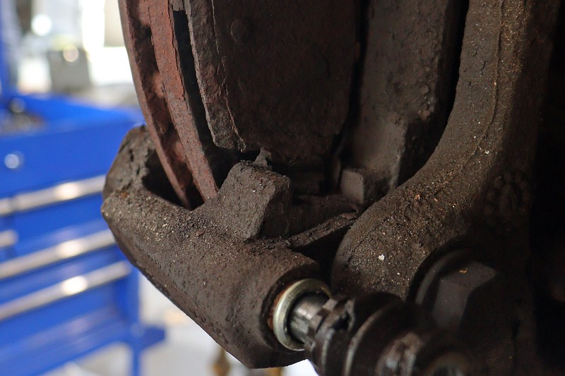 Not only was the inner pad still in place, it was extremely rusted and seized to the caliper bracket.  I had to beat the pad loose with a hammer.