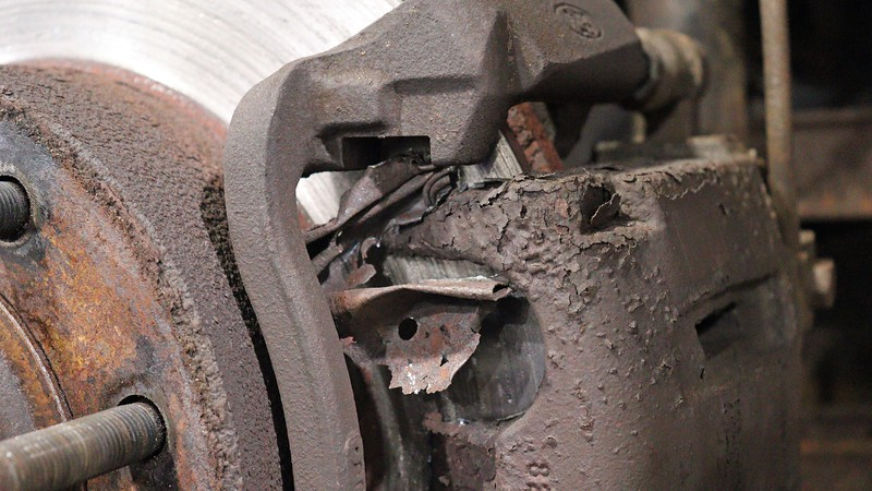 What was left of the outer pad shim was jammed in the caliper bracket.