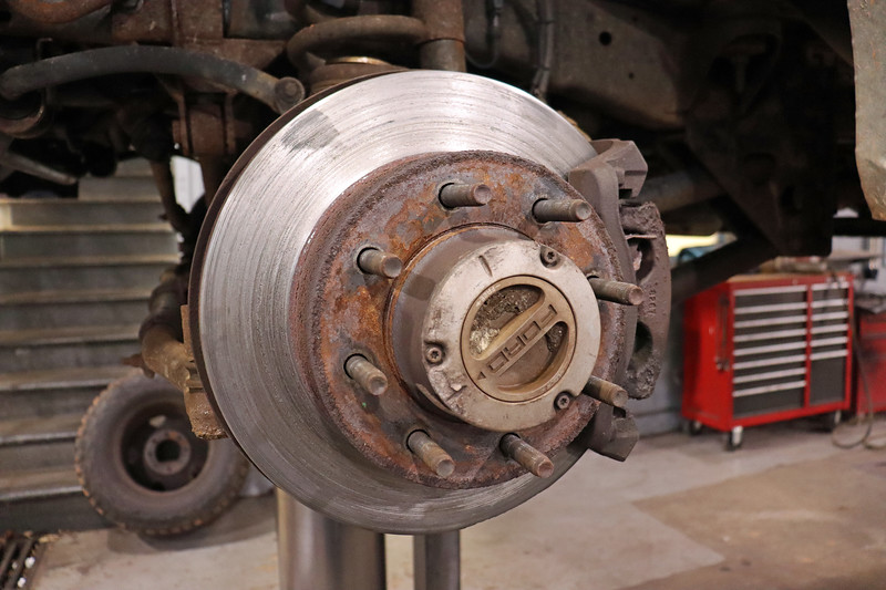 Once in the air, I removed the wheels to perform a brake inspection.  The damaged LF rotor surface gave me an indication of what I would find.