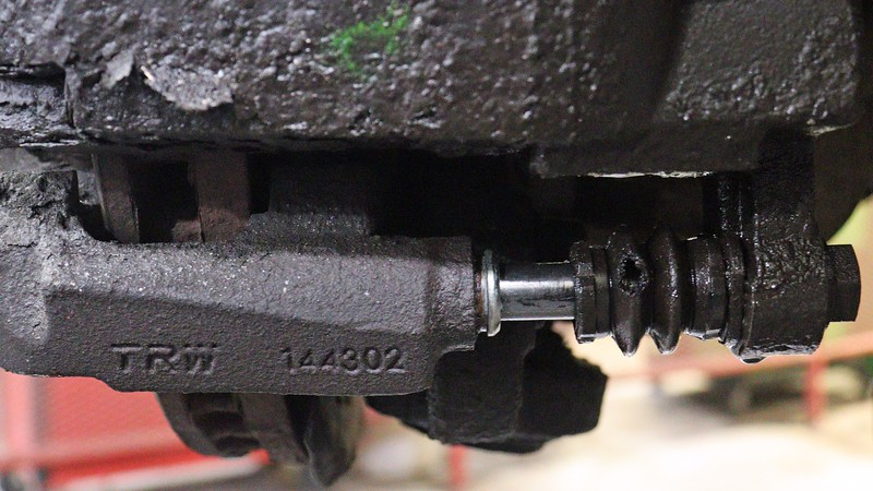 The lower slide pin seems to be almost completely out of the caliper bracket.