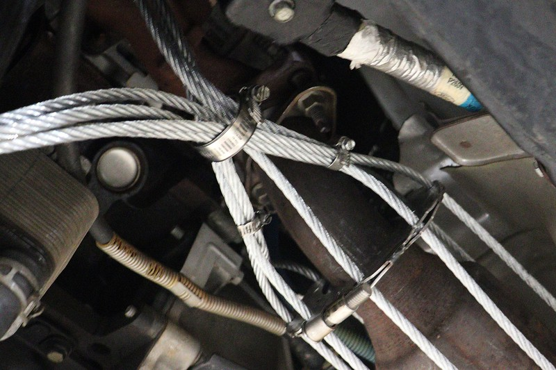 In areas where heat is a concern, a metal hose clamp works well.