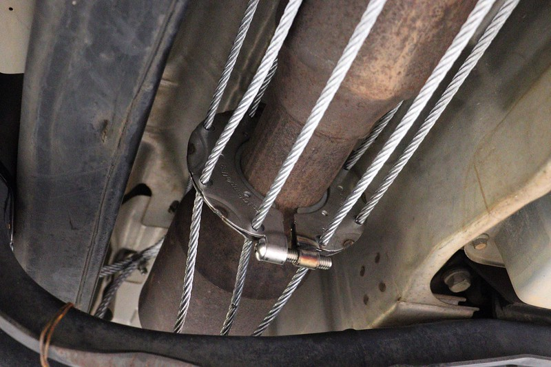 The rearward clamp on this side of the van fit around the pipe without any modification to the heat shield.