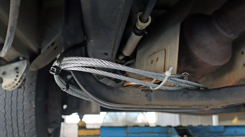 A series of zip-ties and hose clamps keep the cables tied in place.