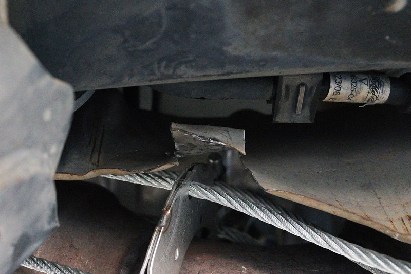 Space is tight around the exhaust system of these vans.  Small modifications to the heat shield were necessary.