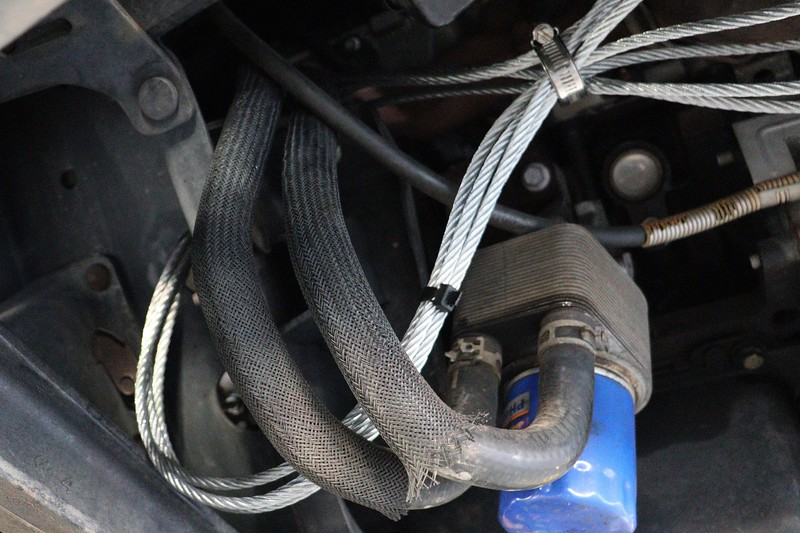 Forward cables wrapped around the vehicle frame.