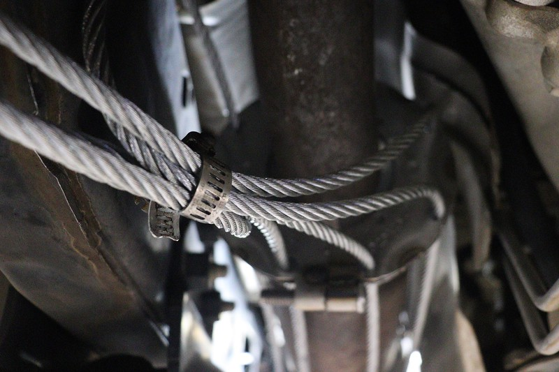 Using a hose clamp to keep the cables in place worked very well.