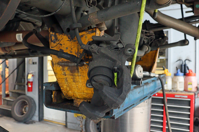 The brake pads are replaced like any other brake job - unbolt the caliper and remove the pads from the caliper bracket.