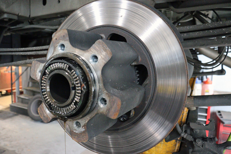 With the axle out of the way, the rotor can now be removed.