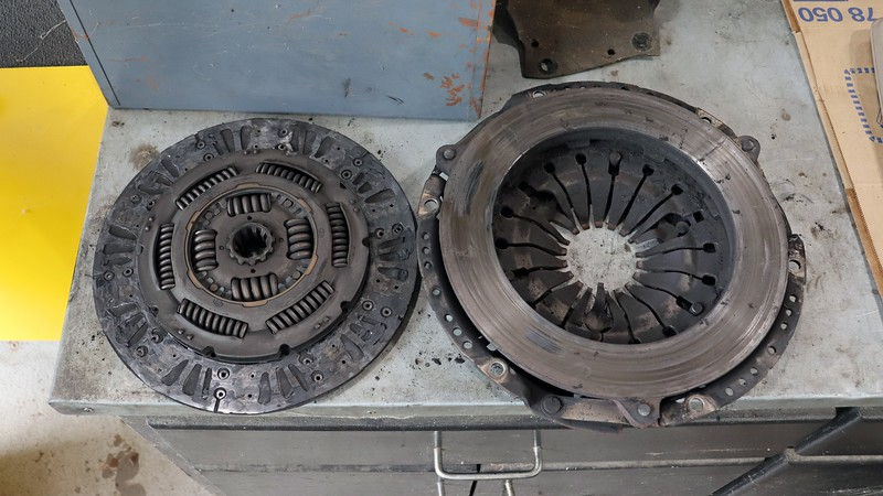 The first thing he noticed is that one side of the clutch disc has no friction material.