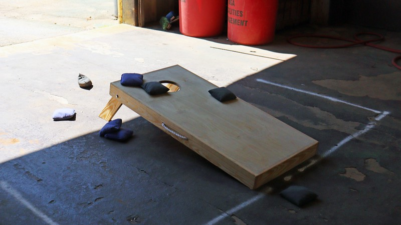 """When Bill asked me if I wanted to be part of the """"Cornhole"""" tournament, I responded with a clueless blank stare that summarized everything I knew about it.  It wasn't until Bill showed me the game board that I realized I had seen it before when I lived in Missouri many years ago, but never knew what it was called.  I don't ever remember seeing in growing up in Pennsylvania.  I figured it must be a Southern phenomenon until I read where the person credited for the modern version of the game was a Harvard graduate."""