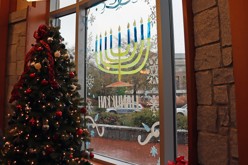 The Menorah next to the Christmas tree made for an interesting visual.