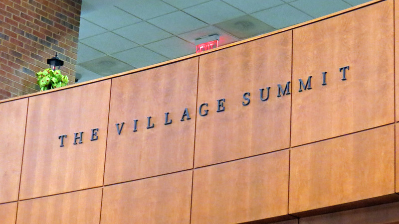 The Village Summit is a large open dining area on the second floor of the building.