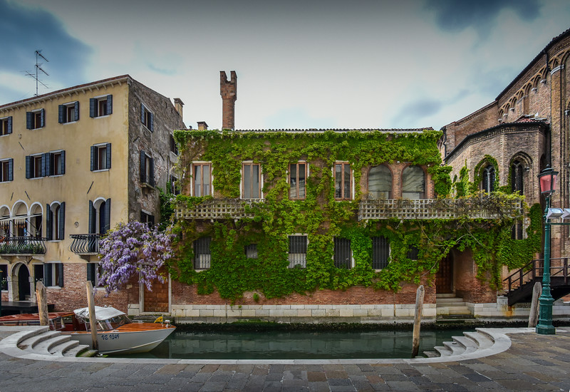 Venitian home, covered in ivy, Venice, Italy.