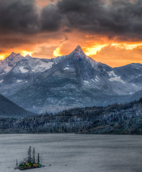 Fire in the sky with Wild Goose Island in the foreground, Glacier National Park, Montana.