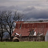 Barn and rainclouds