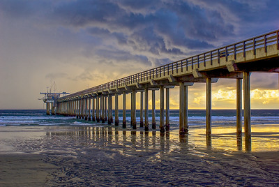 This photo was taken  as an approaching winter storm moving over the Pacific Ocean.  Scripps Pier is located at the Scripps Institute of Oceanography-UC San diego In La Jolla, CA.