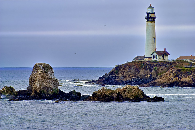 Pigeon Point, CA, USA - View of Pigeon Point Lighthouse in dense fog off of the pacific Coast Highway