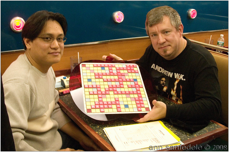 Froilan Mendoza and Kevin McCarthy show off the tie game they had in Round one.  It was one of 5 tie games in the tournament.<br /> Their tying score was 450-450!