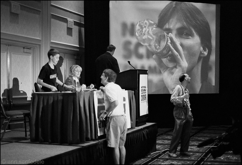 2004, New Orleans.  Trey Wright, on closed circuit screen, is on his way to winning the Nationals.  Commentators are (13 year old Andre Ornish) , Robin Daniel, Chris Cree (back to camera) and Joel Sherman, standing far right.  Facing the stage is Andre's father.