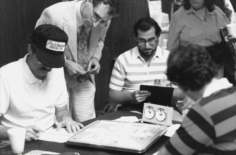 Bob Watson (seated, left) has just defeated Joel Wapnick at the 1988 North American Championship in Reno, Nevada.  Tourney director Joe Edley looks over Bob's shoulder. Milt Wertheimer (center) was the annotator.