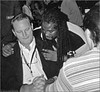 Trey Wright, back to camera, just beat Chris Cree to advance to the Best of 5 round at the National Championship in New Orleans in 2004.  Cree has a stiff upper lip while Marlon Hill offers comfort. It was a heatbreaking loss for Cree.  Wright went on win the whole thing.