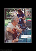 Jimmy Young in the park playing Stefan Fatsis.  Guy with the camera is from People<br /> Magazine.