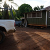 """For some reason, this dirt lot, shack, and pick-up truck, raked by the later afternoon sun streaming through a palm tree, struck me as """"real"""" Hawaii."""