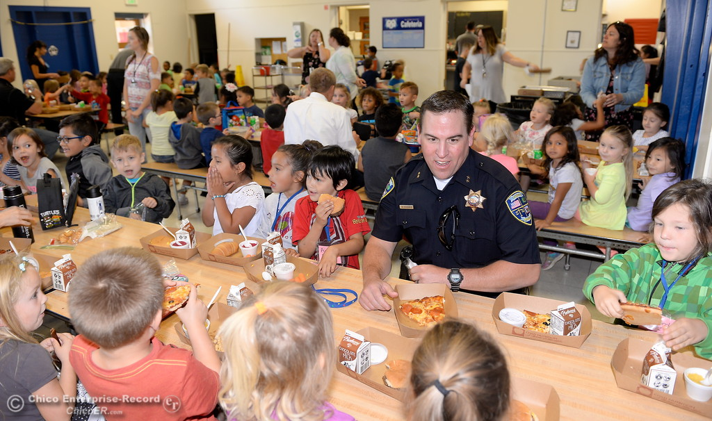 . Chico Police Department Deputy Chief Matt Madden enjoys lunch with students at Chapman Elementary School during the kids and cops event Wednesday Sept. 27, 2017.  (Bill Husa -- Enterprise-Record)