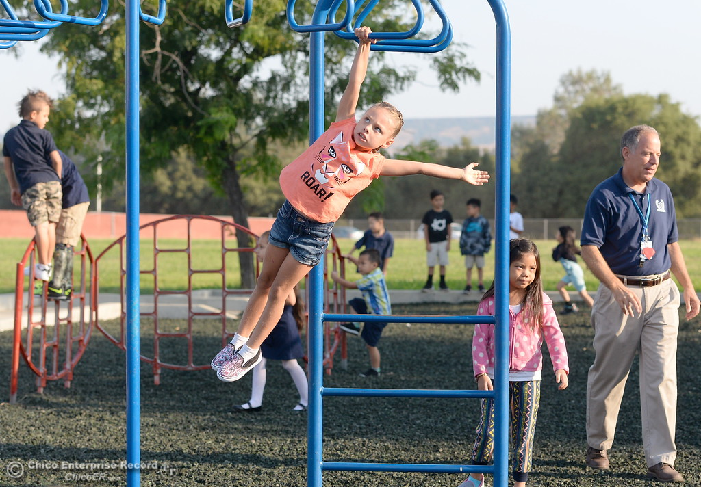. Students enjoy the playground as parents and students arrive for the first day of school at Wyandotte Academy in Oroville, Calif. Wed. Aug. 16, 2017.  (Bill Husa -- Enterprise-Record)