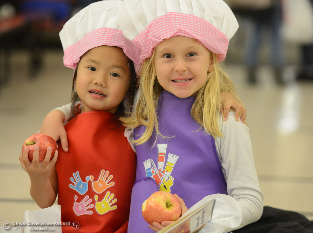 . Matalie Lee, 5, and Maci Bradfield, 7, enjoy their apples as Sierra Avenue School hosts a kids farmers market in partnership with the Center for Healthy Communities Thursday November 9, 2017 in Oroville, California. (Emily Bertolino -- Enterprise-Record)