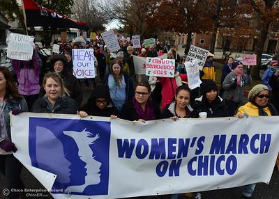 Marchers file past the Chico Municipal Building and City Plaza is filled Saturday, Dec. 21, 2017, for the Chico Women's March in Chico, California. (Dan Reidel -- Enterprise-Record)