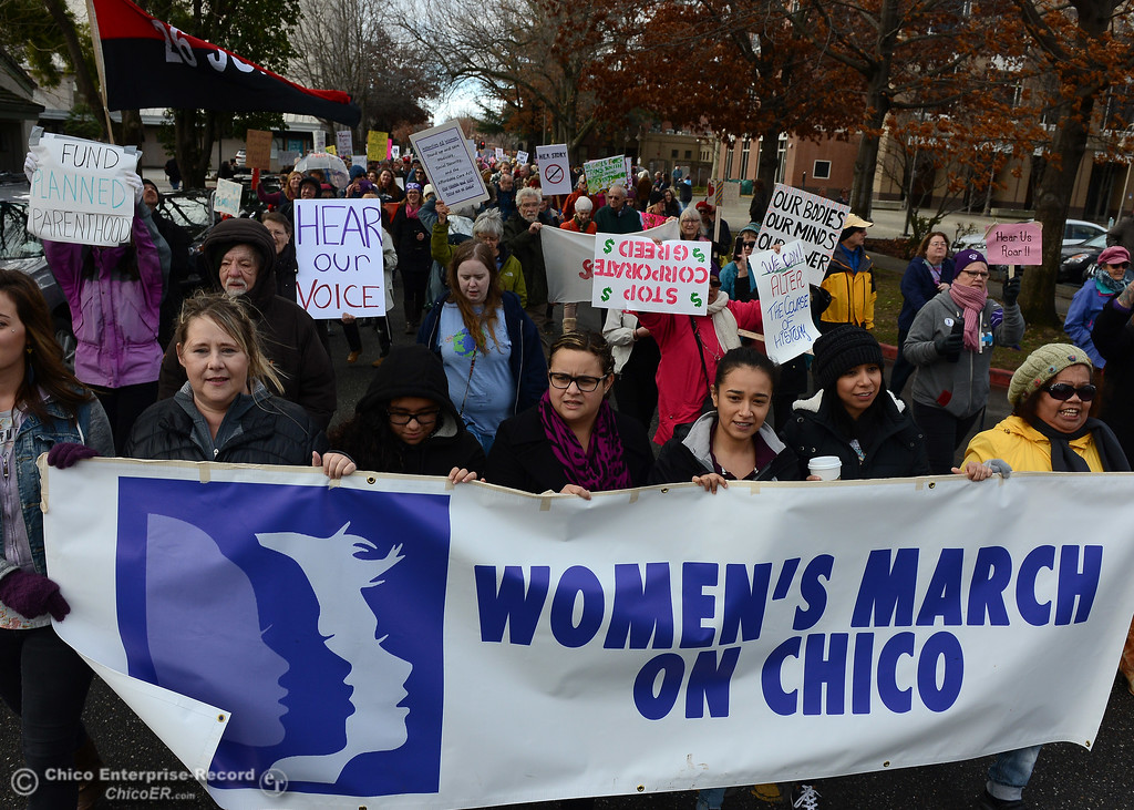 . Marchers file past the Chico Municipal Building and City Plaza is filled Saturday, Dec. 21, 2017, for the Chico Women\'s March in Chico, California. (Dan Reidel -- Enterprise-Record)