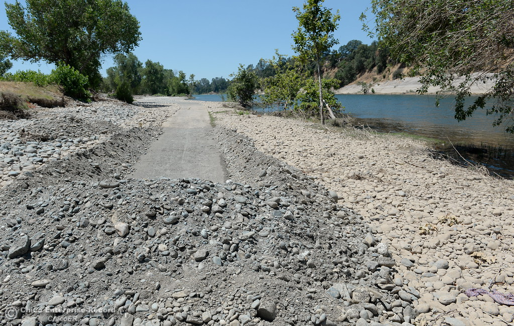 . A walking trail along the Feather River at Riverbend Park shows improvement however much more cleanup remains to be done seen here Monday June 26, 2017.  (Bill Husa -- Enterprise-Record)