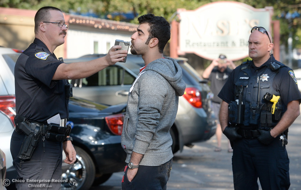 . Chico Police Officer Travis Johnson conducts a field sobriety test on Ali Ali, 21 of Chico.   The Esplanade was closed in one direction following a two vehicle collision with a red Toyota Tundra ending up hitting a tree Tuesday Oct. 17, 2017. The driver of the Tundra Ali Ali, 21 of Chico was arrested for suspicion of DUI. (Bill Husa -- Enterprise-Record)