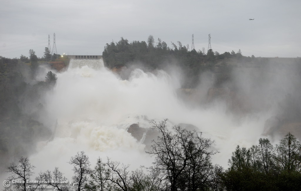 . A bit under 100,000 cfs flows down the damaged spillway as the Lake Oroville Dam Spillway emergency continues in Oroville, Calif. Wed. Feb. 15, 2017. (Bill Husa -- Enterprise-Record)