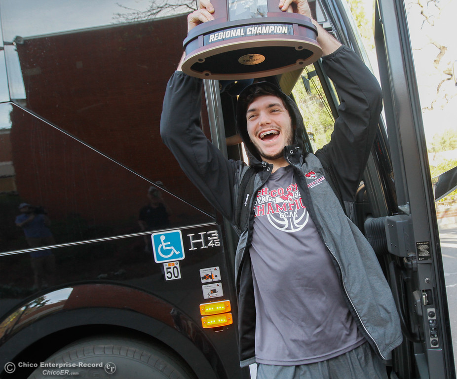 . Holding the national championship trophy Corey Silverstrom, leads the Chico State men\'s basketball team off the bus as the team receives a warm welcome when arriving home after winning the NCAA Division II West Regional Championships game March 14, 2017  in Acker Gym in Chico, California. The team team advances to the Elite Eight tournament for the second time in school history.(Emily Bertolino -- Enterprise-Record)